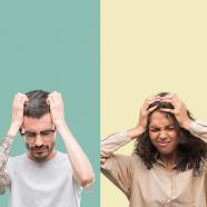 Woman and man exasperated and grabbing their hair