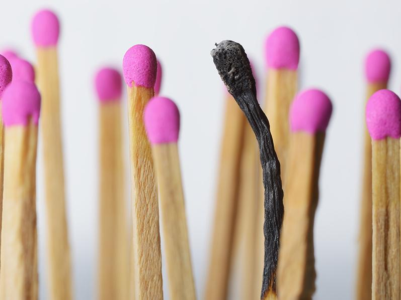 Pink topped wooded matches with one match burned out