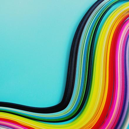 Colorful swirls on the right side of a blue background