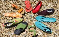 Circle Of Shoes On Pebbly Beach