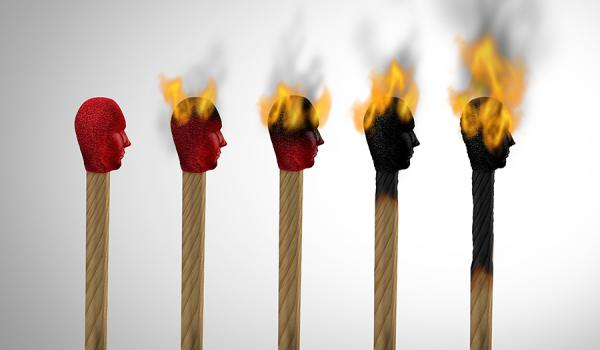 Set against a white background are five matches, with red human heads in the center of the picture. From left to right, they progressively burn. The first match has a red top face with brown wood, and the last match is completely burned black.