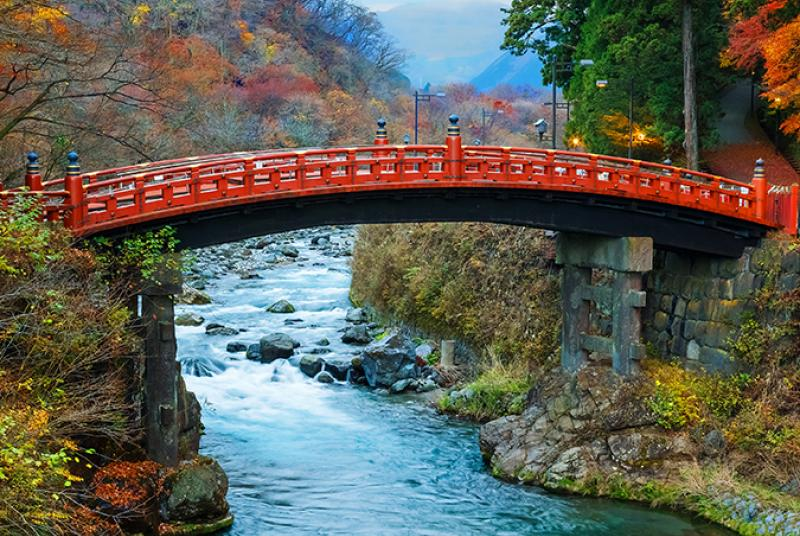 Orange bridge over a turbulent River
